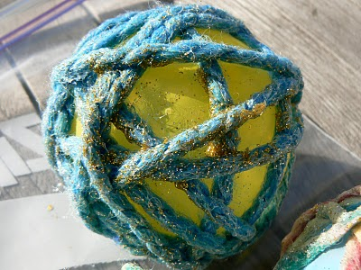 Make Sparkly Yarn Ornaments.