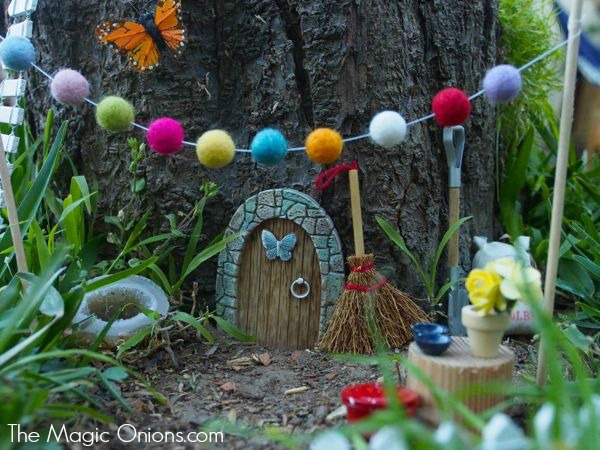 Our new fairy garden in a stump the magic onions for Tree decorations for garden