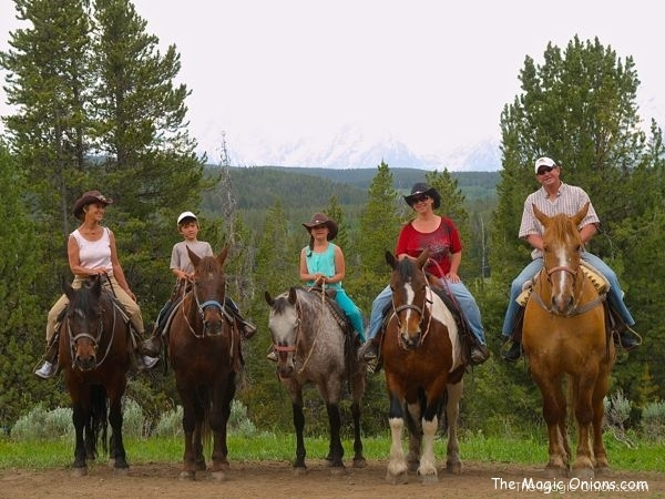 photo of family horseback riding in the Grand Tetons
